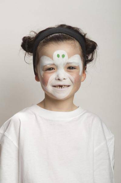 use a brush and white face paint to outline the ghost shape then fill in the outline while avoiding lips and eyes