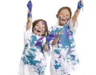 Boy and girl covered in paint