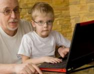 Boy and his grandad both wearing glasses