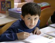 Boy writing at desk