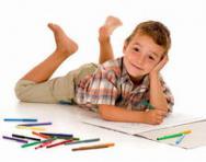 Boy doing drawings