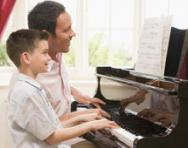 Boy having piano lesson