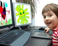 Boy playing on computer