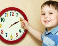 Boy playing with clock