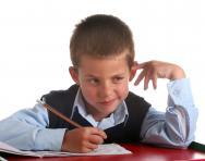 Boy thinking in class
