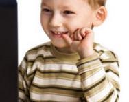 Boy smiling at computer