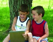 Boys giggling over a book