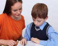 Child and tutor working together