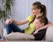 Child and parent watching TV - best educational TV shows for KS2