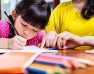 Child editing writing