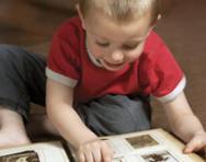Child looking at photo album
