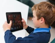 Child looking at tablet computer