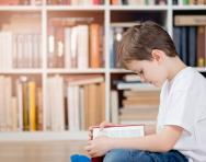 Child reading in a library