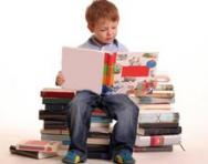 Child sat on stack of books