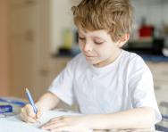 Child writing at home