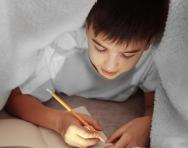 Child writing in diary