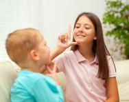Children learning sign language