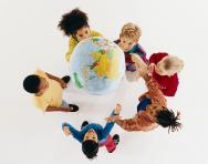 Children playing throwing globe
