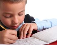 Close up of boy practising writing