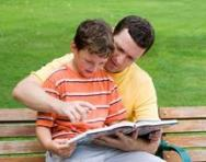 Dad reading with son