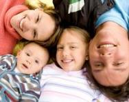 Family lying on the floor looking happy