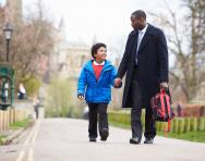 Father and son walking to school