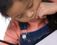 Child writing in pencil