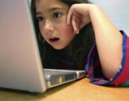 Girl engrossed in her computer