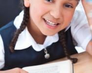 Girl reading at her desk