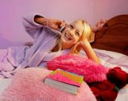 Girl relaxing in her bedroom on the phone