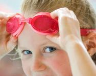 Girl in primary school wearing swimming goggles