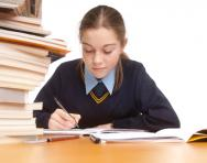 Girl writing at desk