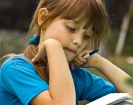 Girl reading and studying
