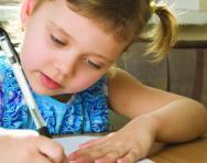 Girl practising handwriting