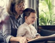 Grandmother and child reading together