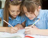 Schoolgirls writing