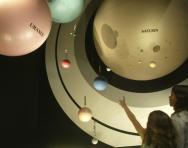 Children visiting a space museum exhibit