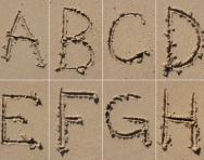 Letters in sand