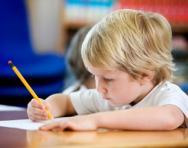 Little boy writing