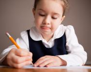 Little girl concentrating on her work