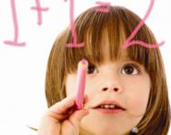Little girl doing sums
