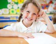 Little girl in classroom smiling