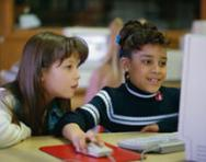 Little girls at computer