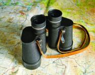 Map and binoculars