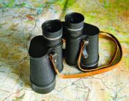 Map and binoculars