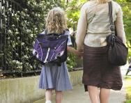 Mum and daughter walking to school