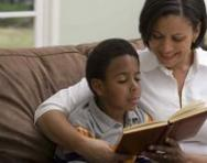 Mum reading a book with her son