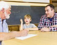 Parent, teacher and child meeting