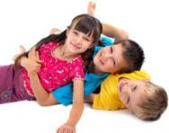 Children playing 'pile on'