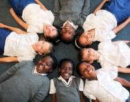 School children lying in a circle